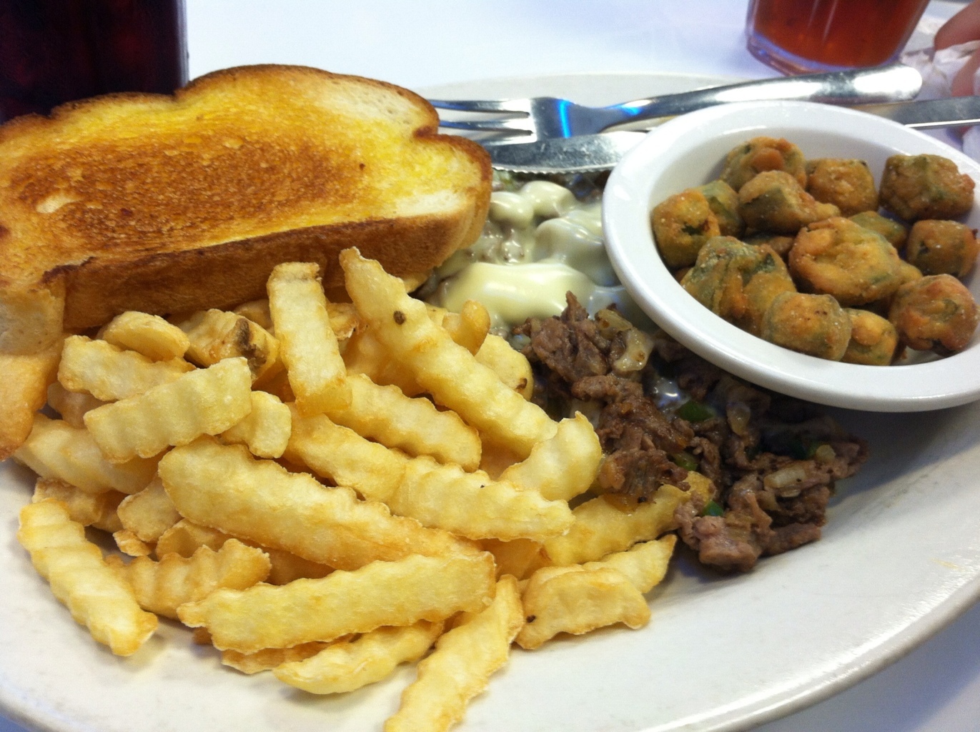 Philly Cheesesteak Plate with Fried Okra and French Fries at Wayne's Family Diner
