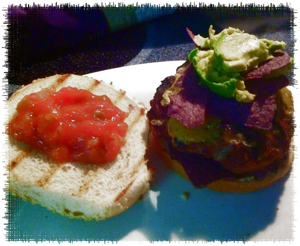 Taco Rubbed Burgers with avocado and blue corn chips